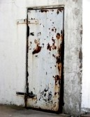 1717993-rusty-metal-door-on-an-abandoned-industrial-building