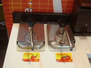 A_pump_for_chili_sauce_and_tomato_ketchup,_Georgetown,_Penang,_Malaysia